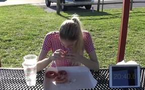 Skinny Girl Eating 50 Donuts