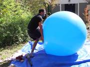 Slow Mo Guys Popping Huge Balloon