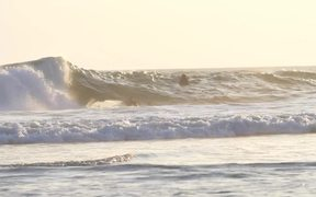 Slow Motion Shot of a Man Surfing