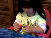 2 Year Old Girl Solves Rubiks Cube