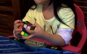 2 Year Old Girl Solves Rubiks Cube