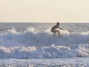 Tracking Shot of a Man Surfing in the Sea