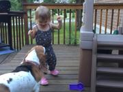 Toddler And Dog Dancing On Deck