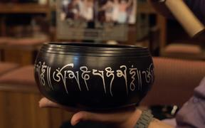 Close-Up Shot of a Singing Bowl in Use