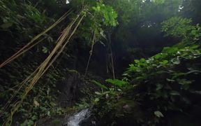 Tracking Shot of a Small Waterfall
