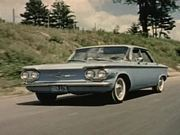 Blue 1960 Corvair On The Road