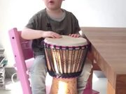 Kid Plays The Djembe