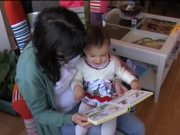 Litlle Girl Is Reading a Book Acting Like Animals