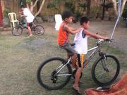Kids Riding The Bike