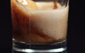Pouring Cola in Macro View - Slow Motion