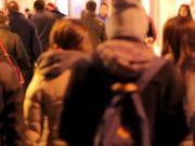 Pedestrians in Town at Night