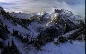 Flying Over Snow Covered Mountains