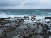 A Choppy Sea Crashing Onto Rocks