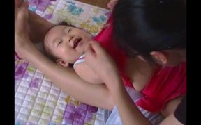 Baby Mideum being tickled