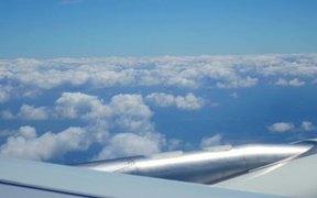 Airplane flying thru beautiful clouds