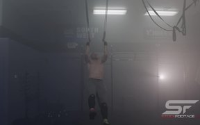 Male Gymnast Practicing on Still Rings