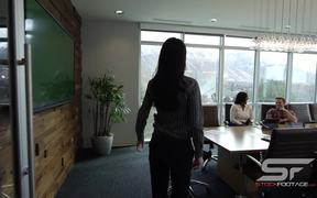 Woman Walking into Conference Room Slow Motion