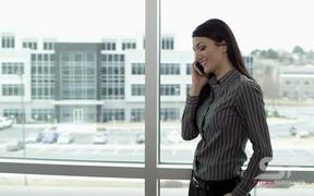 Panning View of Woman Making Call