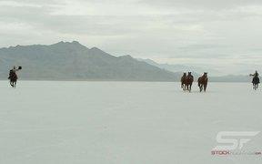 Horses Running Across Salt Flats in Ultra HD