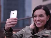 Woman Taking Picture of Herself with Smartphone