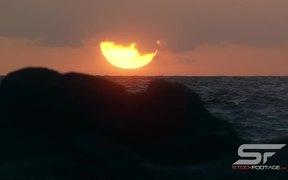 Slow Motion Shot of Sun Setting Over the Ocean