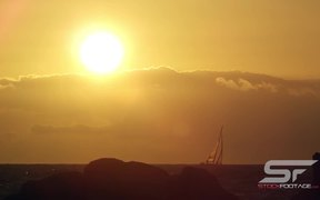 Static View of Sailboat on the Horizon at Sunset