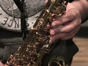 Musician Plays A Gold Saxophone Close Up