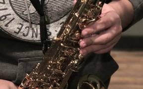 Musician Plays A Gold Saxophone Close Up