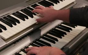 A Musician Plays a Piano and Key Board