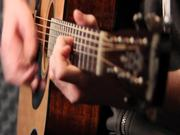 Acoustic Guitar Player in Studio Close Up