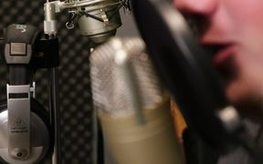 A Singer Singing in a Sound Booth Close Up