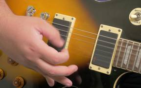 Fingers Picking a Guitar Close Up in HD