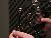 Musician Plays a Tambourine Close Up
