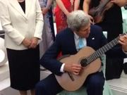 Secretary Kerry Plays Musician's Guitar