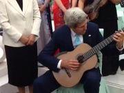 Secretary Kerry Plays Musician's Guitar
