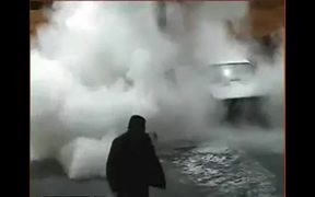 Driver Uses A Match To Look Into The Gas Tank