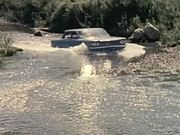 1960 Corvair Uses Stream as Roadbed