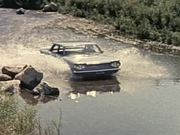 1960 Corvair Uses Stream as Roadbed
