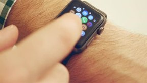 Man Using and Wearing Apple Smart Watch