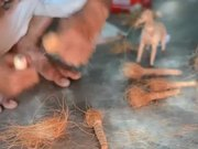 Artisan Making a Coir Toy