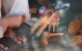 Artisan Making a Coir Toy