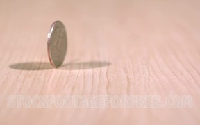 Quarter Coin Spinning on Desk