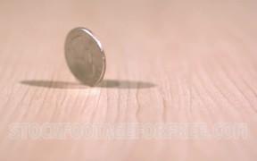 Quarter Coin Spinning on Desk