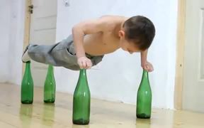 World's Strongest Kid Does Push-Ups On Bottles