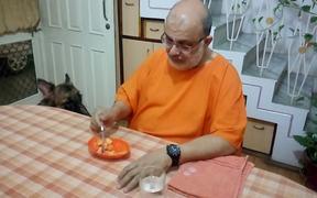 Man Feeding a Dog