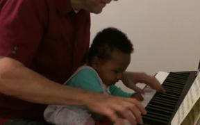Chris and Augie Playing the Piano